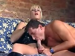 Two guys have fun with hot girl and tranny on sofa