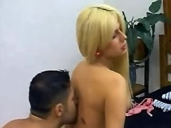 Blonde transsexual dominates beefy guy in his place