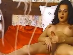 Blazing latina tranny jerks off big yummy cock