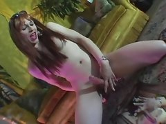 Shemale plays with her cock n dildo